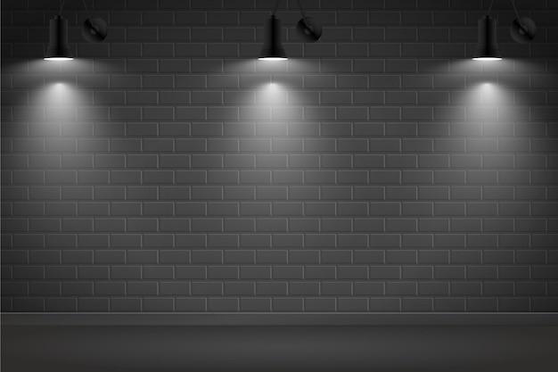 Luci spot su sfondo scuro muro di mattoni Vettore gratuito