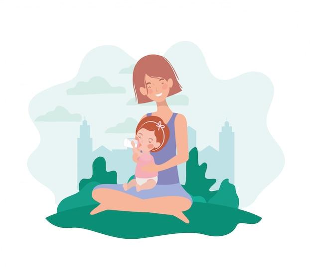 Madre incinta di gravidanza seduta con la bambina nel campo Vettore Premium