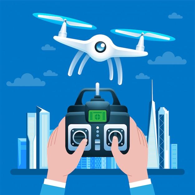 Mani che guidano drone tramite telecomando Vettore Premium
