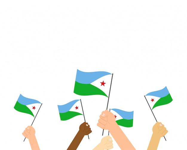 Mani in possesso di bandiere di gibuti i Vettore Premium