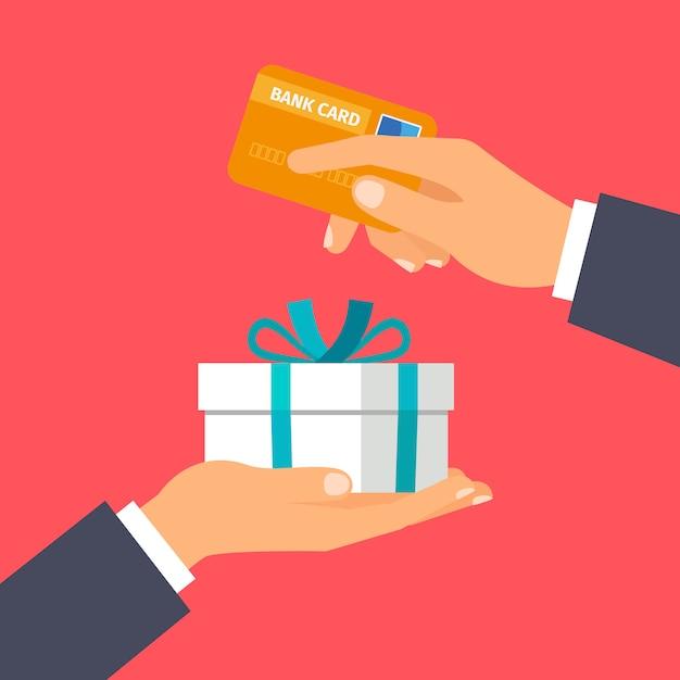Mani in possesso di carta di credito e presente Vettore Premium