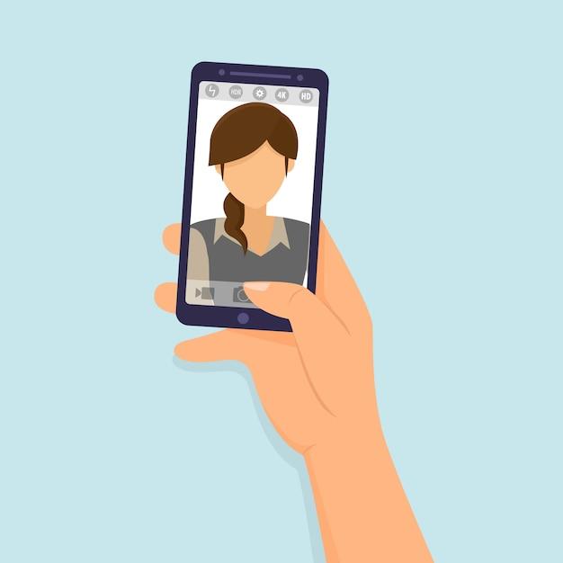 Mani tenere smartphone prendendo foto di selfie Vettore Premium
