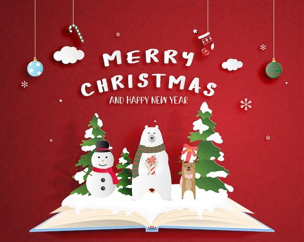 Manifesto di celebrazione di natale nello stile del taglio della carta. arte digitale della carta artigianale. orso polare e cervi e pupazzo di neve felici sul libro aperto con fondo e decorazione rossi. Vettore Premium