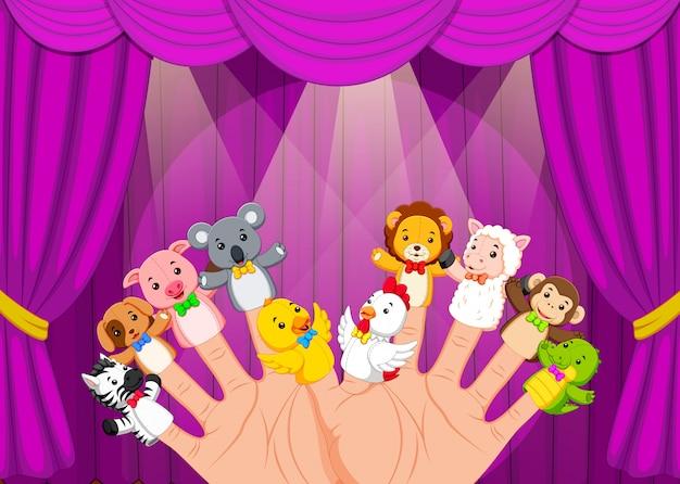 Mano che indossa 10 marionette da dito sul palco Vettore Premium