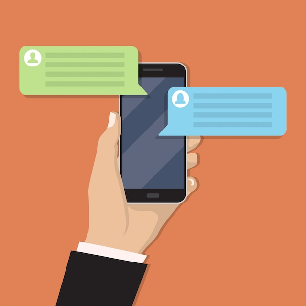 Mano che tiene smartphone con messaggio di chat Vettore Premium