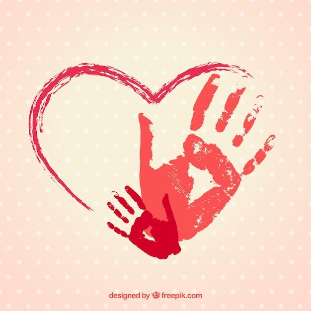 Mano cuore dipinto con impronte Vettore gratuito