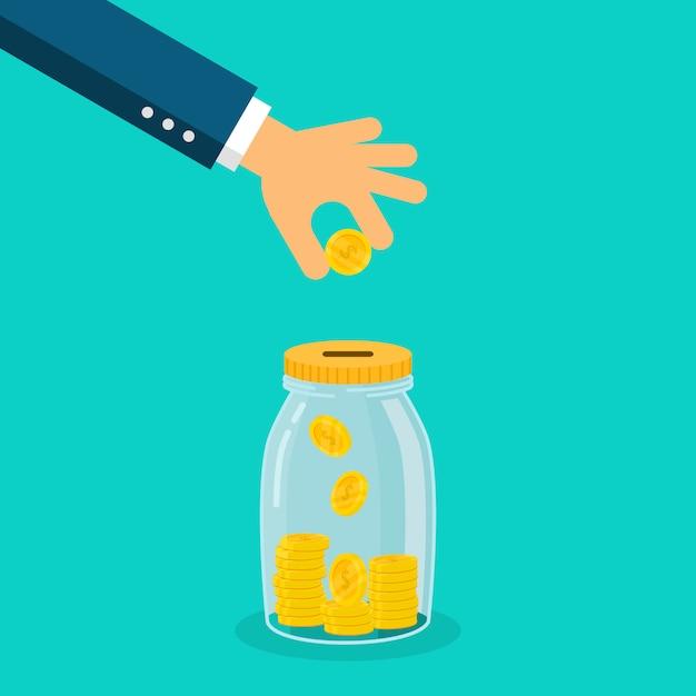 Mano dell'uomo d'affari che mette moneta nel barattolo dei soldi isolato su fondo blu. Vettore Premium