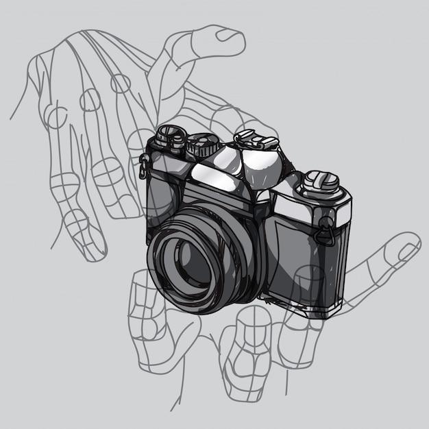 Mano della macchina fotografica Vettore Premium