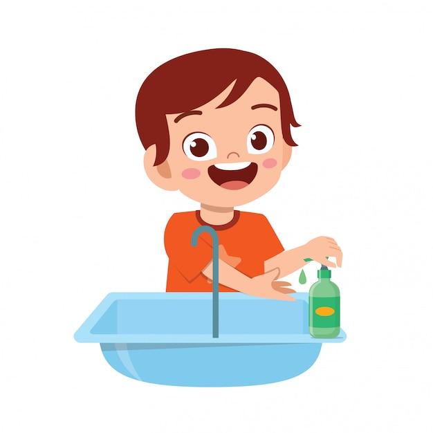 Mano sveglia felice del lavaggio del ragazzo del bambino in lavandino Vettore Premium