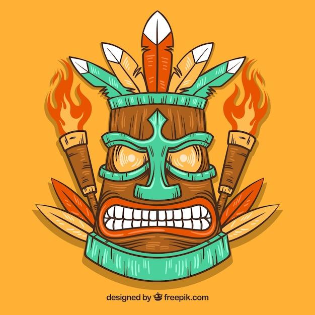 Maschera di tiki arrabbiata disegnata a mano con le torce Vettore gratuito