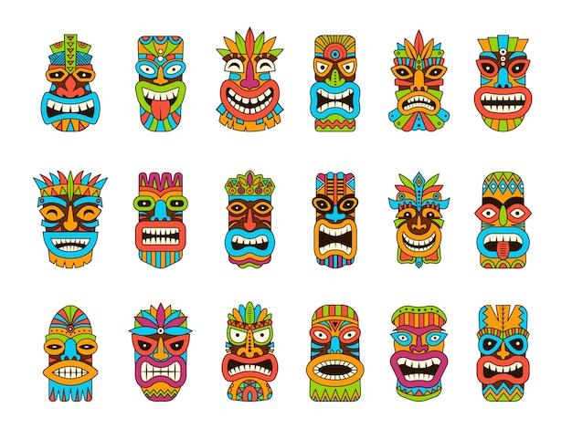Maschere tiki. illustrazioni della maschera colorate simboli di legno tradizionali africani del totem tribale dell'hawaii Vettore Premium