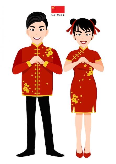 Maschio e femmina cinesi in costume tradizionale, saluto del popolo cinese e bandiera cinese sul personaggio dei cartoni animati bianco del fondo Vettore Premium