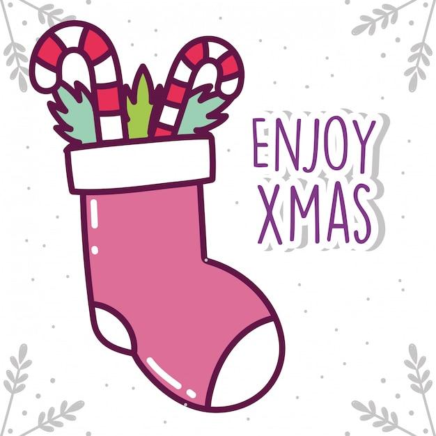 Menta piperita di calza e caramelle di celebrazione di buon natale Vettore Premium