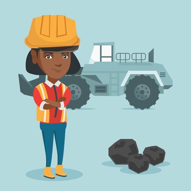 Minatore in piedi con un escavatore. Vettore Premium