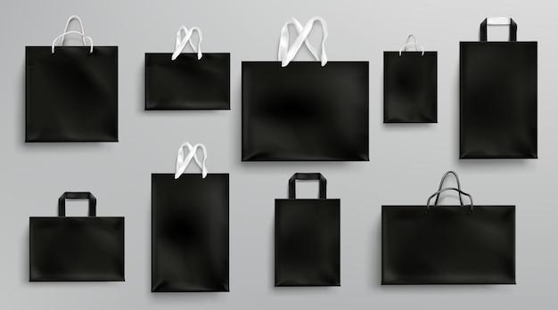Mockup di sacchetti della spesa di carta, set di pacchetti neri Vettore gratuito