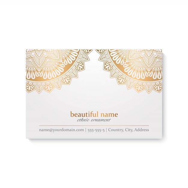 Modello di biglietto da visita di lusso con stile indiano, colore bianco e dorato Vettore gratuito