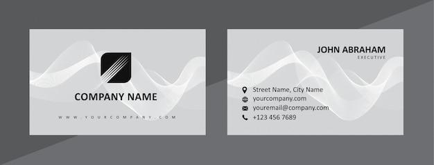 Modello di biglietto da visita nero e grigio naturale dinamico Vettore Premium