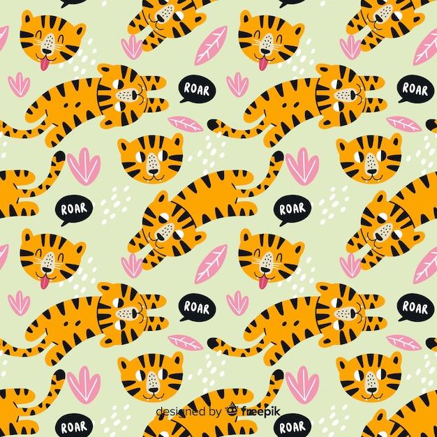 Modello di tigri disegnati a mano Vettore gratuito