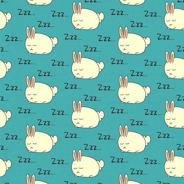Modello senza cuciture del coniglio addormentato su verde Vettore Premium