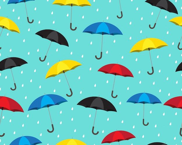 Modello senza cuciture di ombrello colorato con gocce di pioggia Vettore Premium