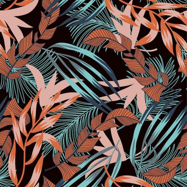 Modello senza cuciture di tendenza con foglie e piante tropicali brillanti Vettore Premium
