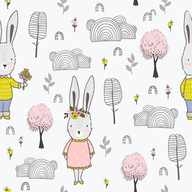 Modello senza cuciture disegnato a mano sveglio del piccolo ragazzo e della ragazza dei conigli Vettore Premium