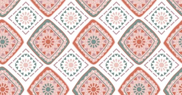 Modello senza cuciture geometrico verde rosa in stile africano Vettore Premium