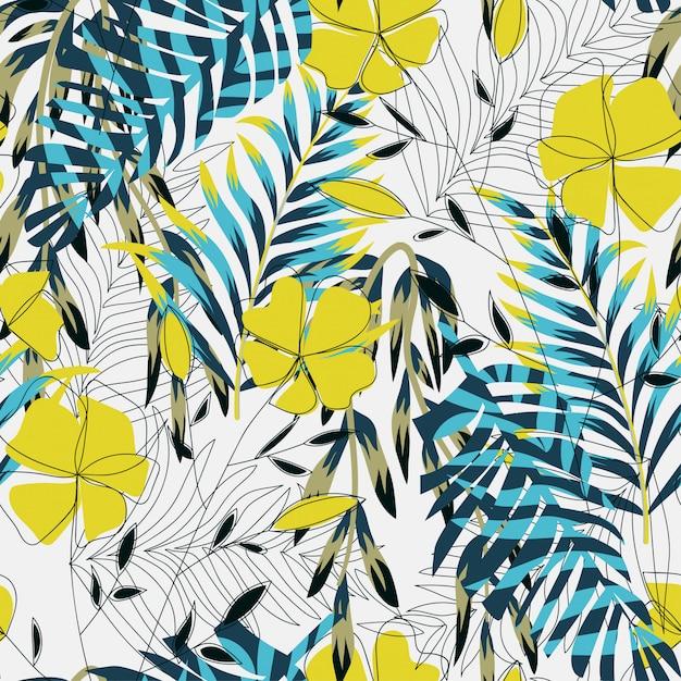 Modello senza cuciture luminoso tropicale con foglie e piante colorate Vettore Premium