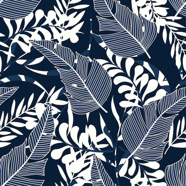 Modello senza cuciture tropicale con piante e foglie luminose Vettore Premium