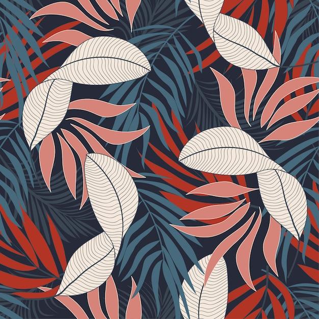 Modello tropicale senza cuciture alla moda con fiori rossi e blu Vettore Premium