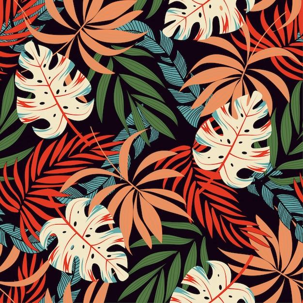 Modello tropicale senza cuciture alla moda con piante e foglie rosa e gialle luminose Vettore Premium