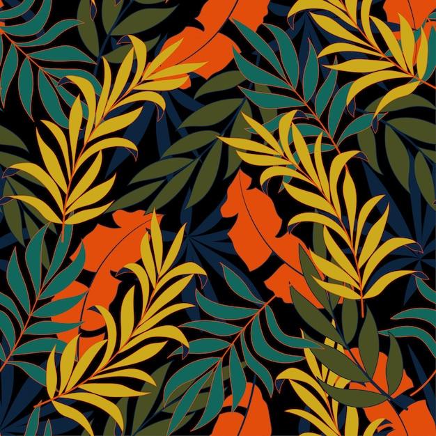 Modello tropicale senza cuciture alla moda con piante e foglie verde brillante e blu Vettore Premium