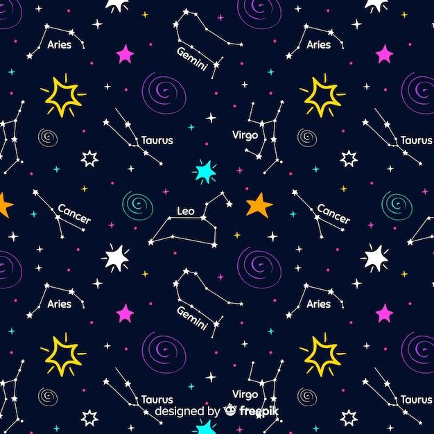 Modello zodiacale colorato disegnato a mano Vettore gratuito