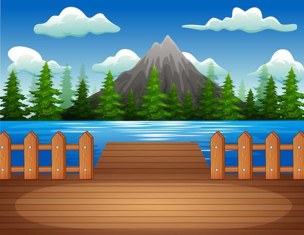 Molo di legno con vista sul lago e sulla montagna Vettore Premium