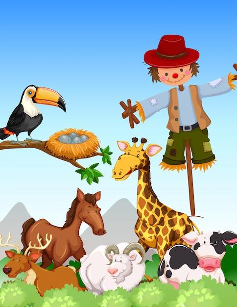 Molti animali selvaggi e spaventapasseri nel campo Vettore gratuito