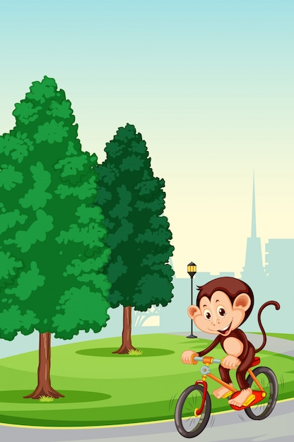 Monkey riding bicycle nel parco Vettore gratuito