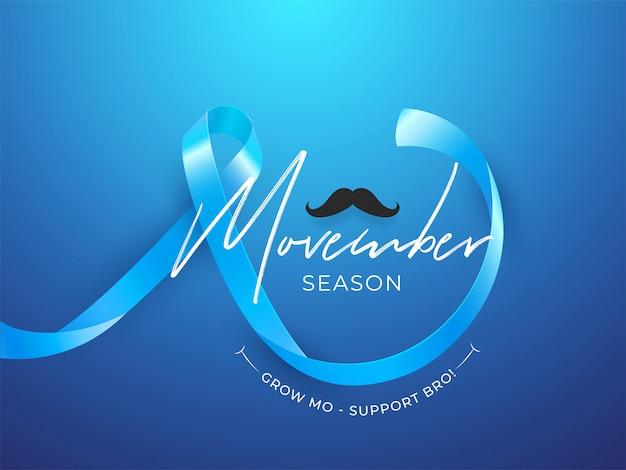Movember season design con nastro e baffi aids Vettore Premium