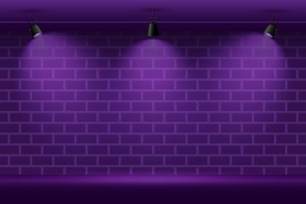 Muro di mattoni con sfondo di luci spot Vettore gratuito