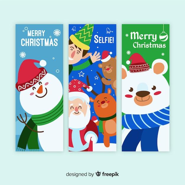 Natale che saluta banner di caratteri di natale Vettore gratuito