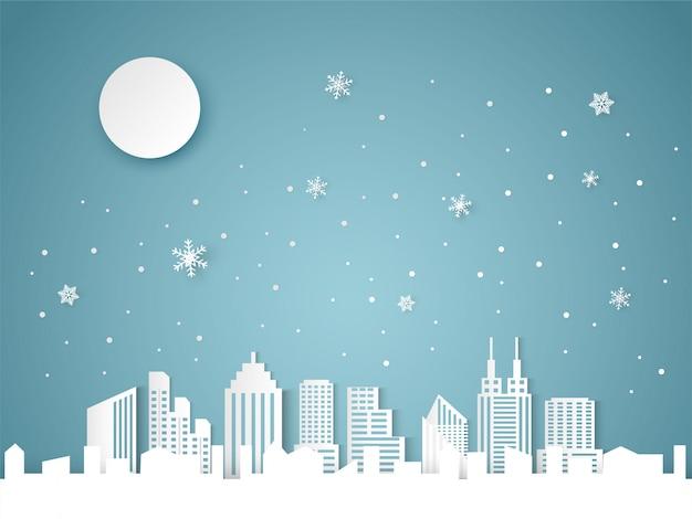 Natale e felice anno nuovo sfondo blu con paesaggio urbano e fiocco di neve Vettore Premium