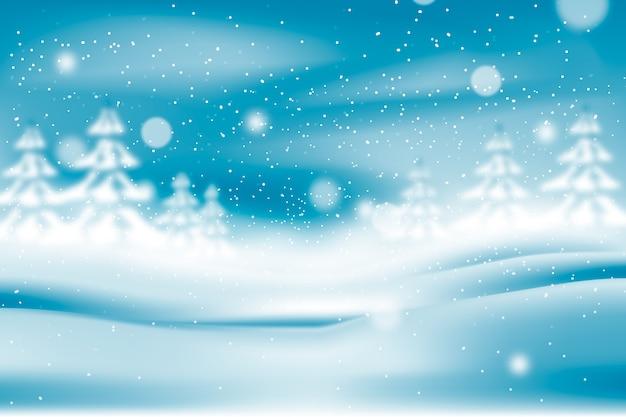 Nevicate realistiche offuscate e alberi bianchi Vettore gratuito