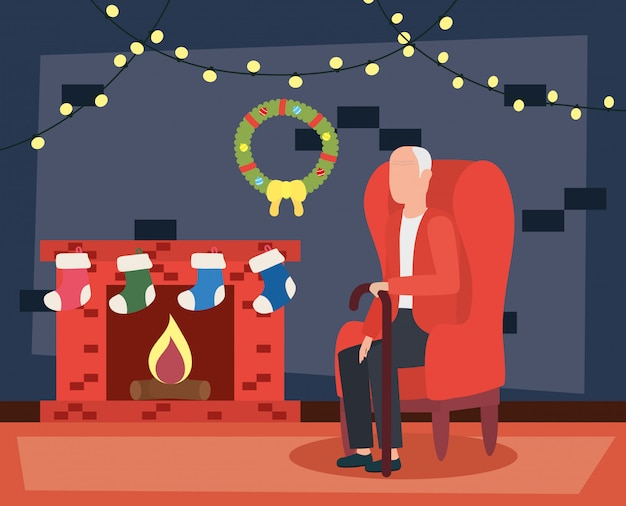 Nonno in soggiorno con decorazioni natalizie Vettore gratuito