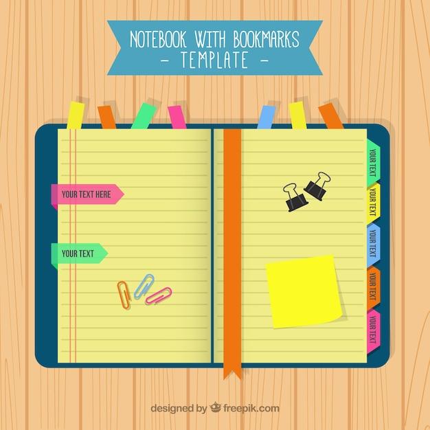 Notebook con i segnalibri colorati Vettore gratuito