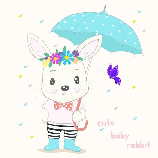 Ombrello sveglio della stretta del fumetto del coniglio piccolo a disposizione un giorno piovoso. stile disegnato a mano Vettore Premium