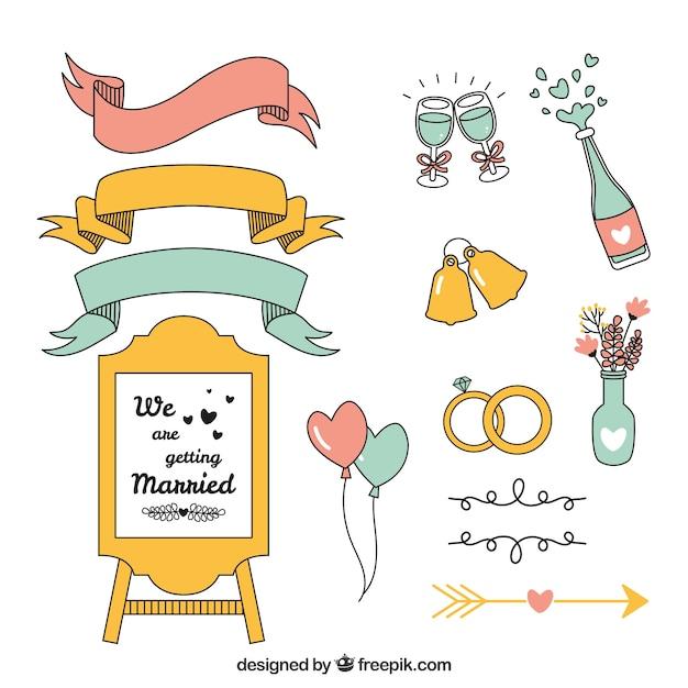 Pacchetto disegnato a mano di elementi di nozze Vettore gratuito