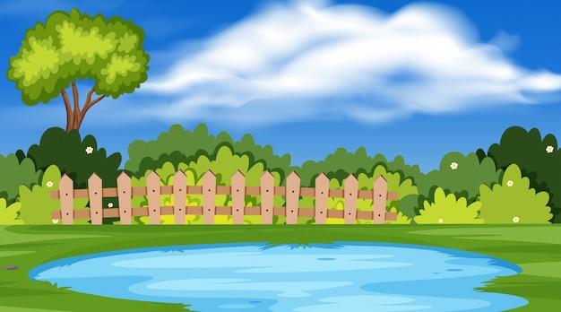 Paesaggio con stagno nel parco Vettore Premium