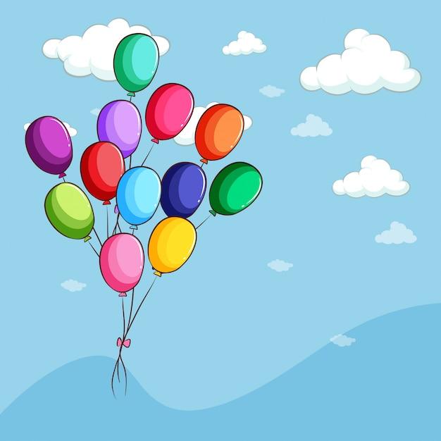 Palloncini colorati che galleggiano nel cielo Vettore gratuito