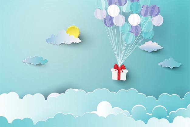 Palloncino sopra nuvola con regalo. Vettore Premium