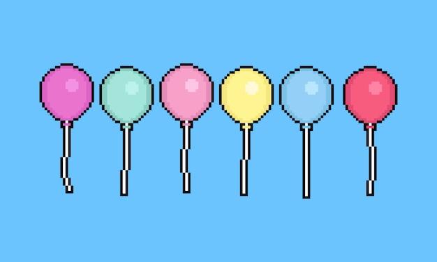 Pallone di pixel art cartoon set.8 bit. Vettore Premium