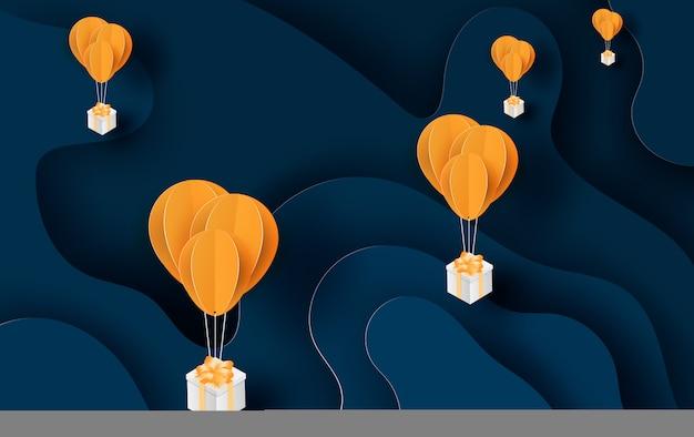 Pallone galleggiante giallo e confezione regalo Vettore Premium